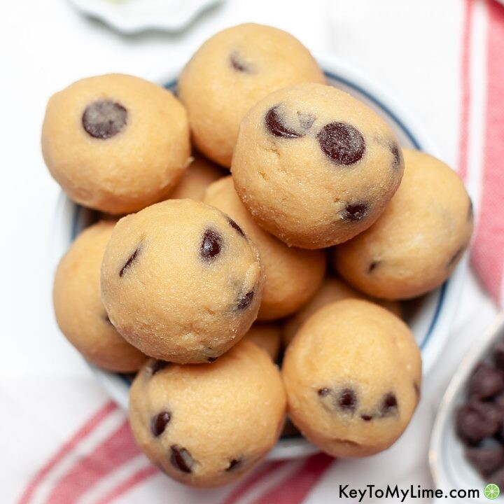 An overhead image of a pile of keto cookie dough balls.