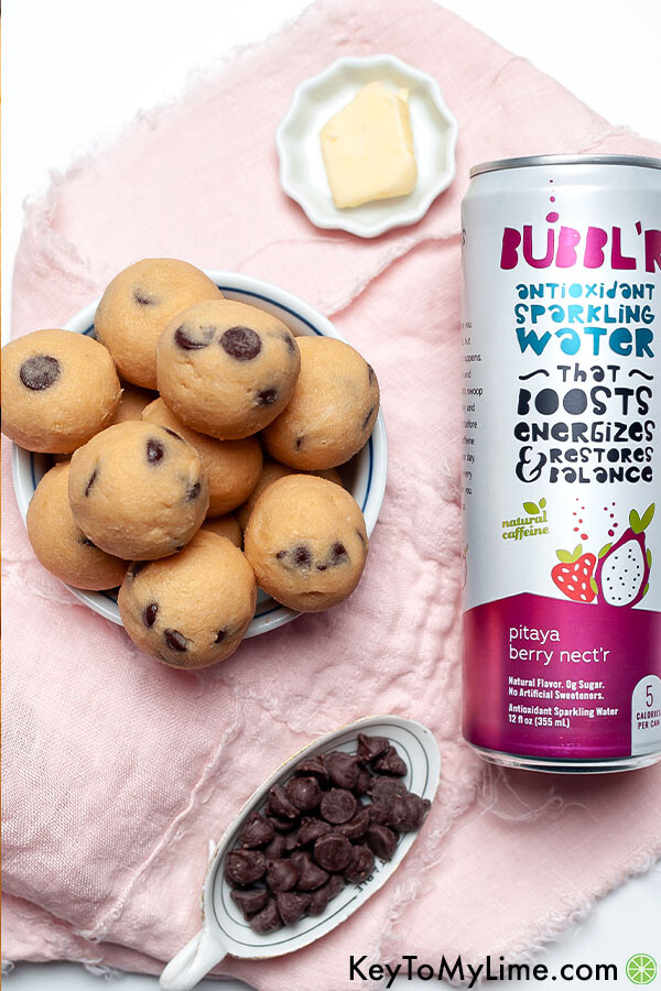 Keto cookie dough next to a can of sparkling water.