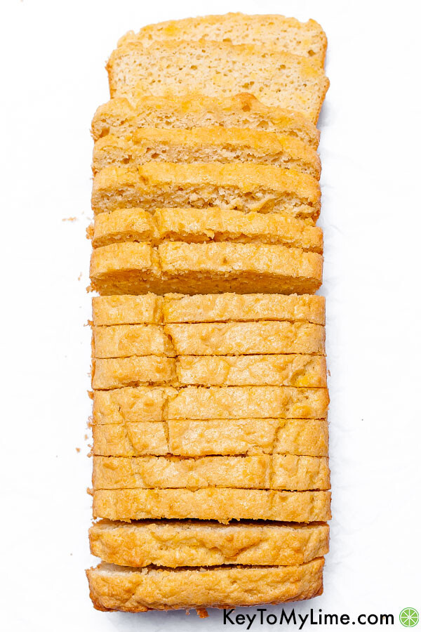 An overhead image of a keto bread loaf cut into thin slices.