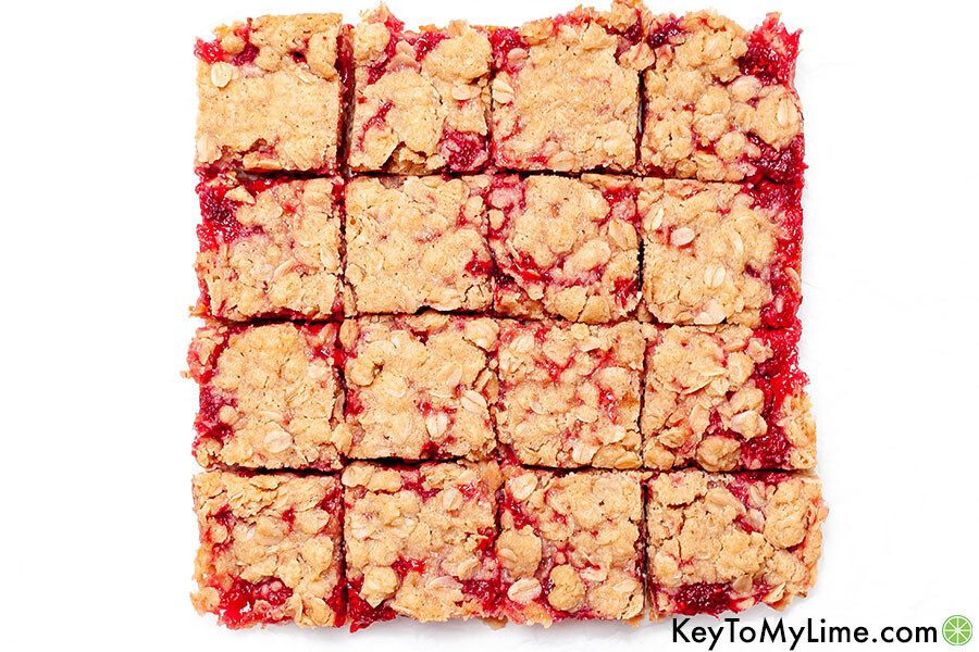 Raspberry crumble bars cut into 16 pieces.
