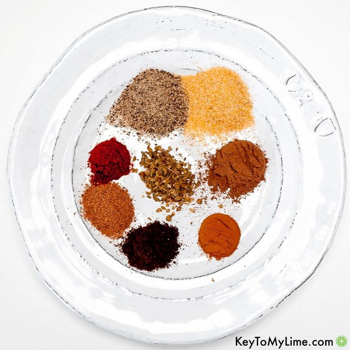 Shawarma seasoning spices on a white plate.