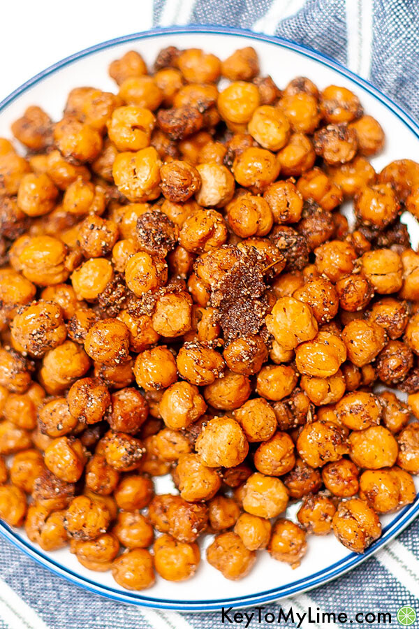 A close up image of roasted chickpeas coated in shawarma seasoning.