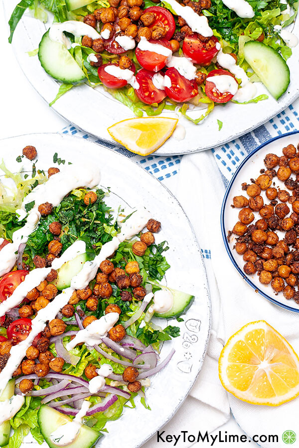 Salad on two plates with a creamy vegan dressing.
