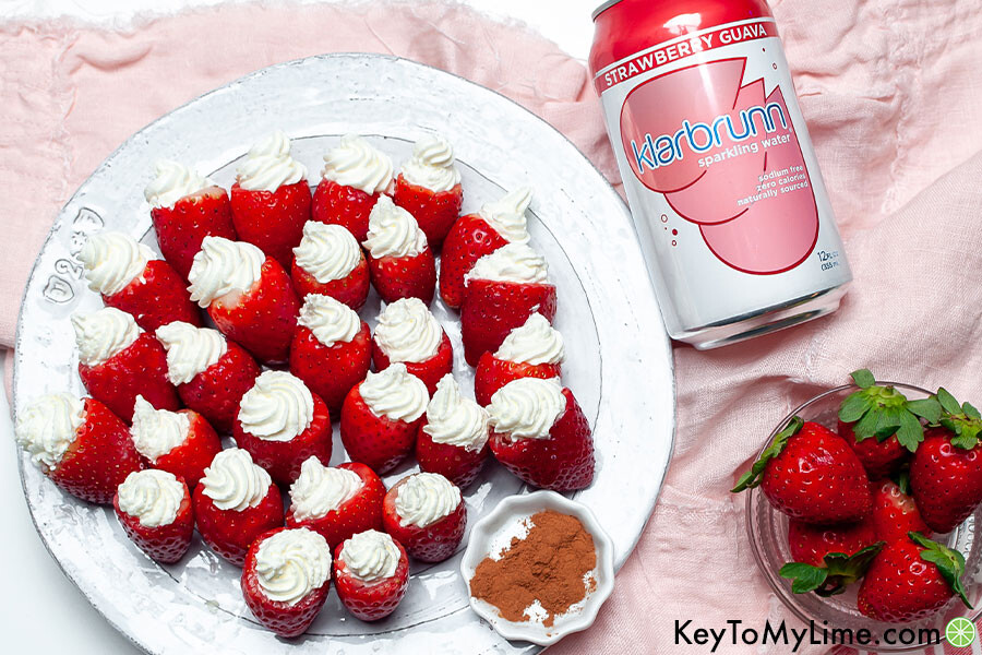 Stuffed strawberries next to a can of strawberry sparkling water.