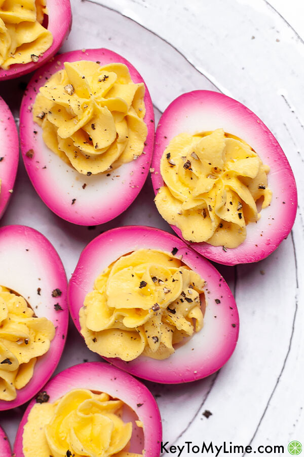 A close up image of beet pickled hard boiled eggs.