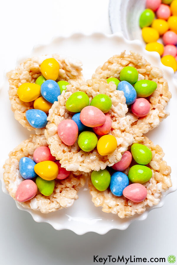 An overhead image of Rice Krispie nests with colorful egg candies.