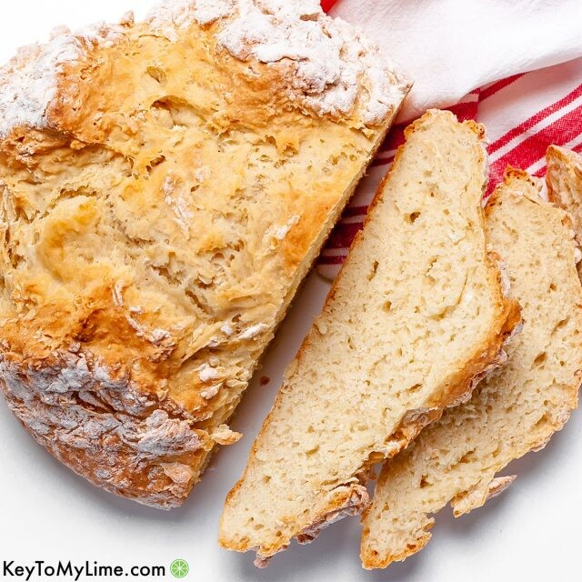 An Irish soda bread loaf with sliced pieces of bread.