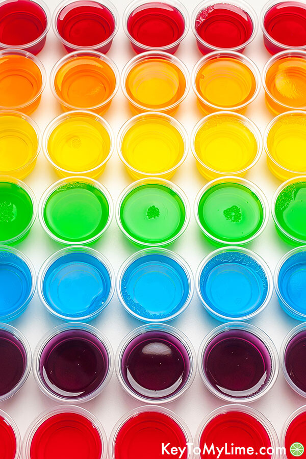 An image of jello shots arranged in rainbow order.
