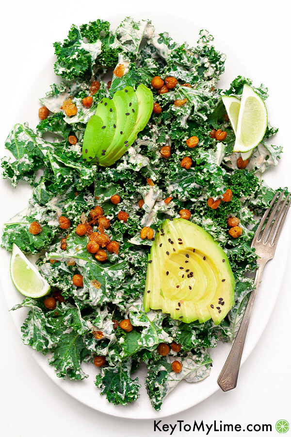 A kale and avocado salad dressed with spicy ranch dressing.