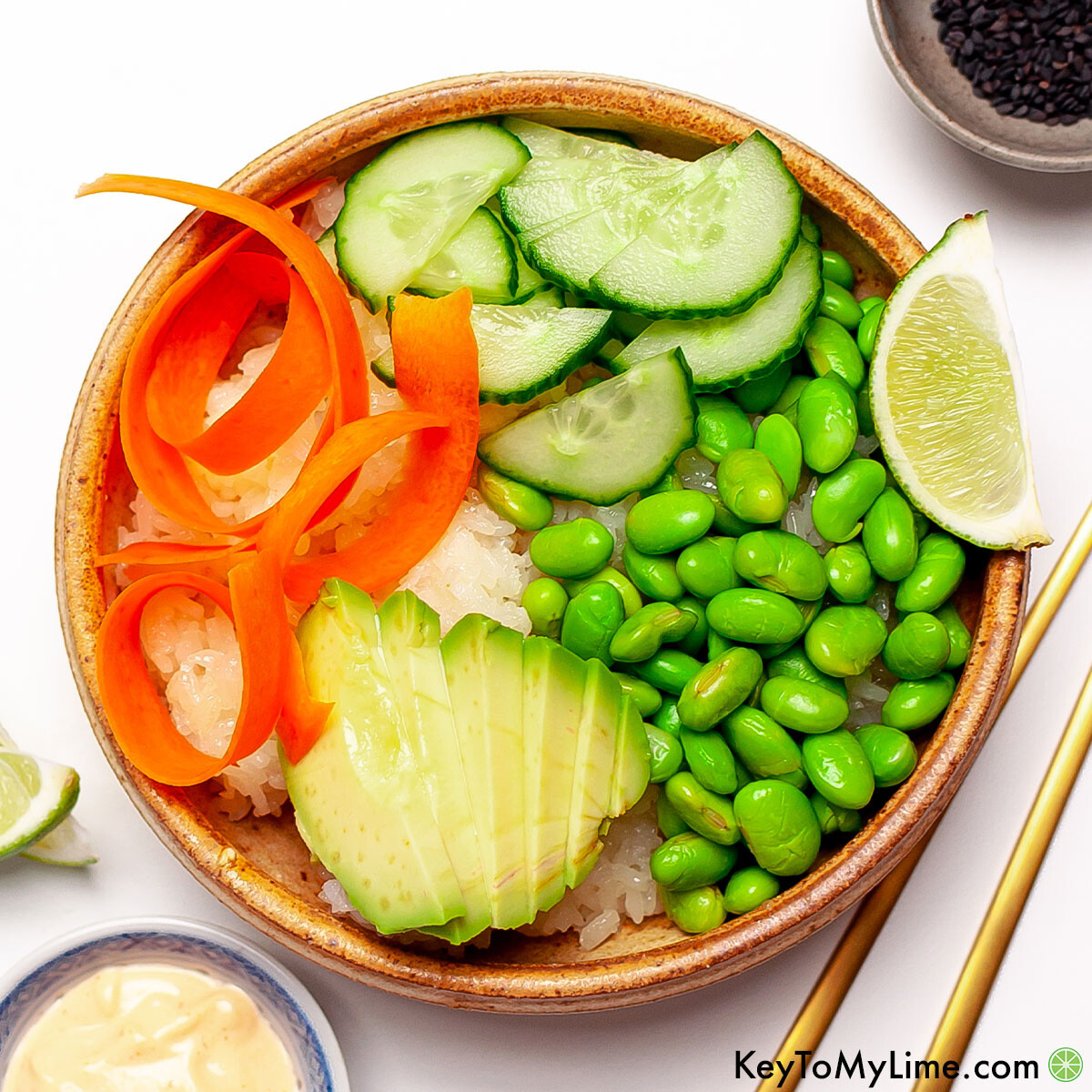 An overhead image of vegetarian sushi bowl with sriracha mayo recipe.