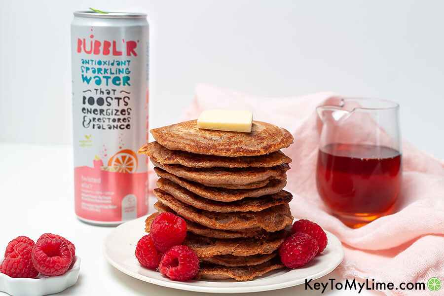 A pancake stack next to a can of sparkling water.