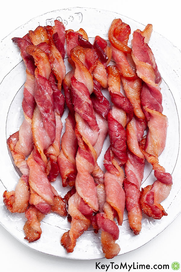 Twisted bacon on a white plate.