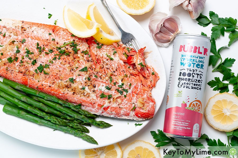 A salmon filet on a platter next to a can of BUBBL'R.