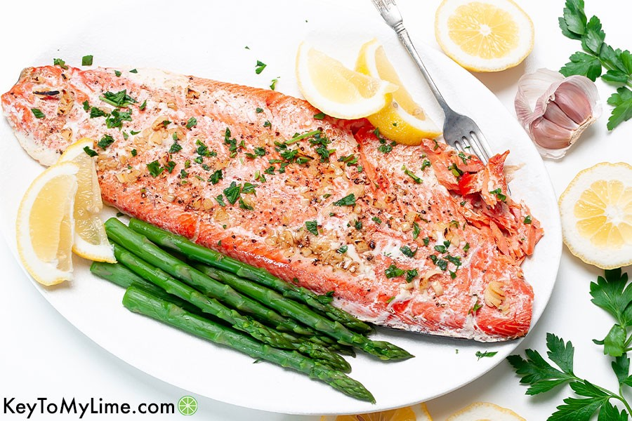 A horizontal image of a baked salmon filet.