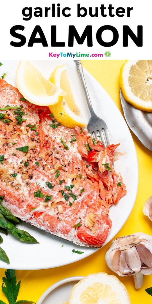 A Pinterest pin image with a picture of garlic butter salmon and title text.