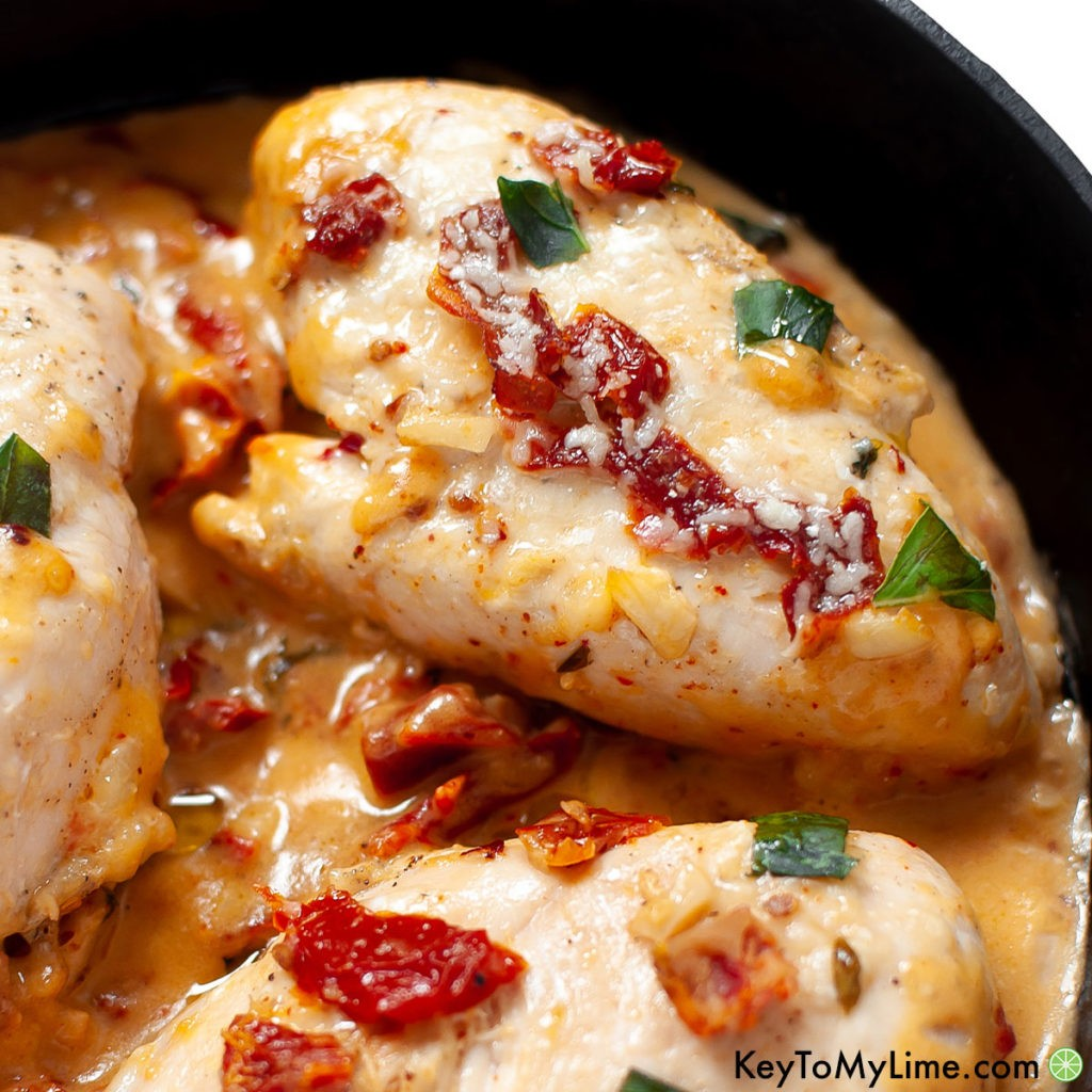 A close up of a creamy Marry Me Chicken breast.