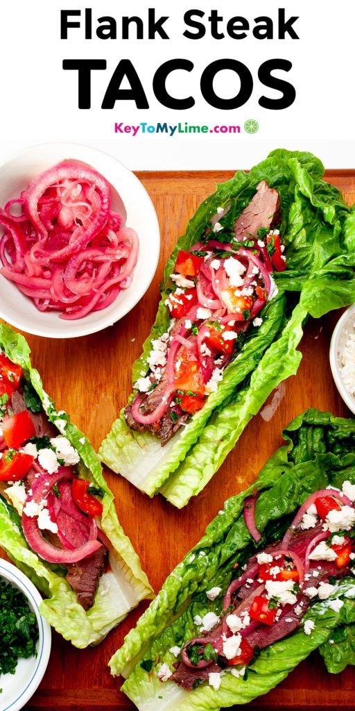 A Pinterest pin image with a picture of steak lettuce tacos and title text.