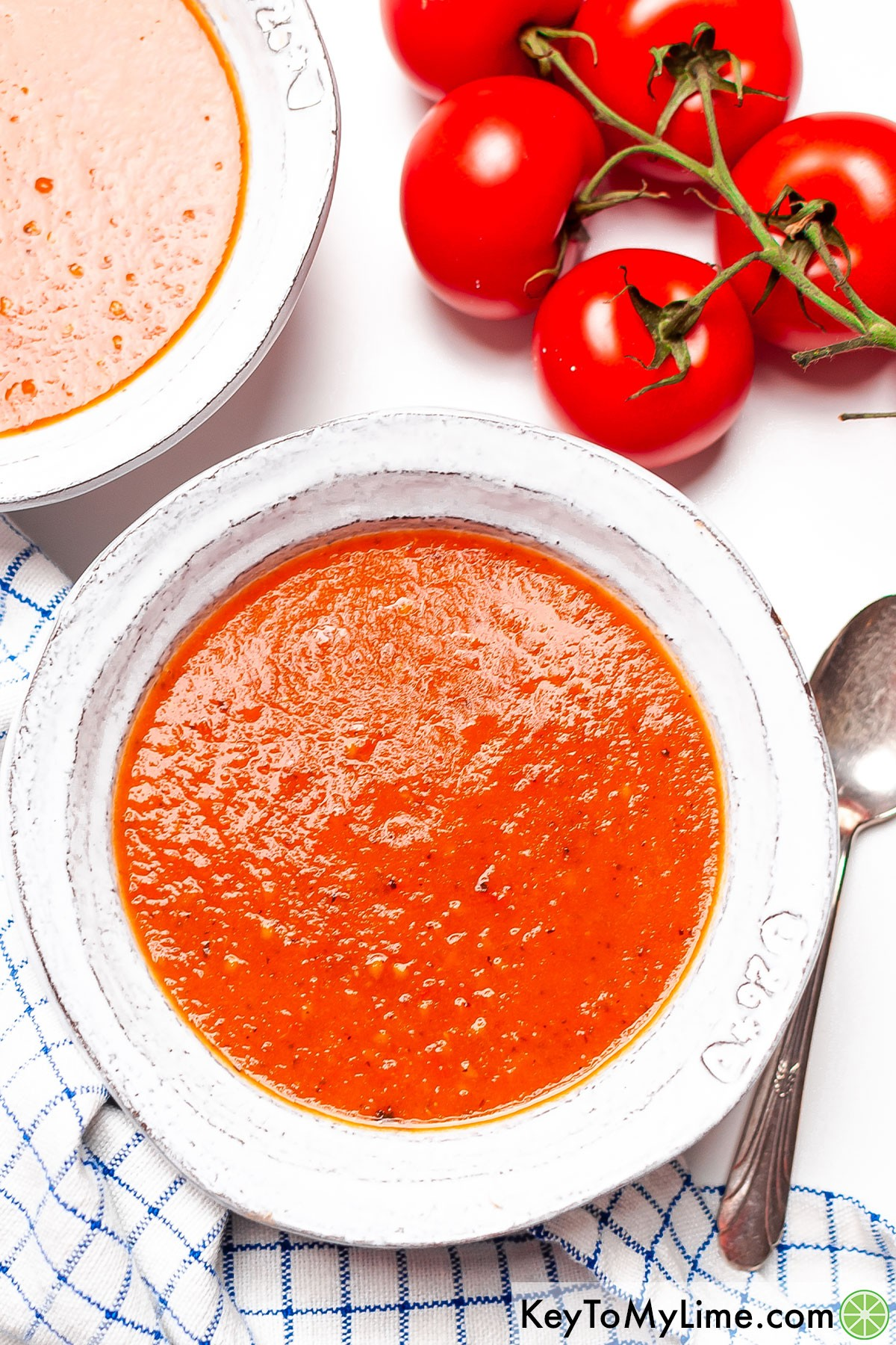 Two bowls of fresh homemade tomato soup.
