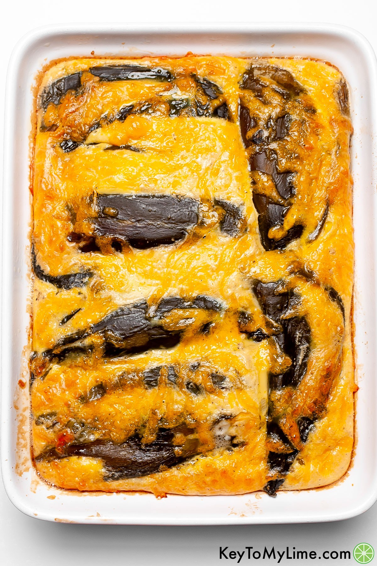A picture of chile relleno casserole showing how the casserole is puffy and fluffy right when it comes out of the oven.