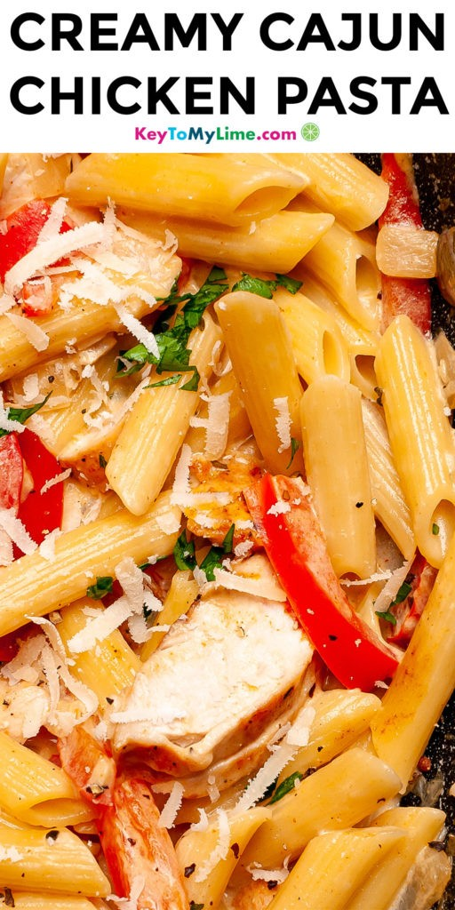 A Pinterest pin image of creamy Cajun chicken pasta with title text.