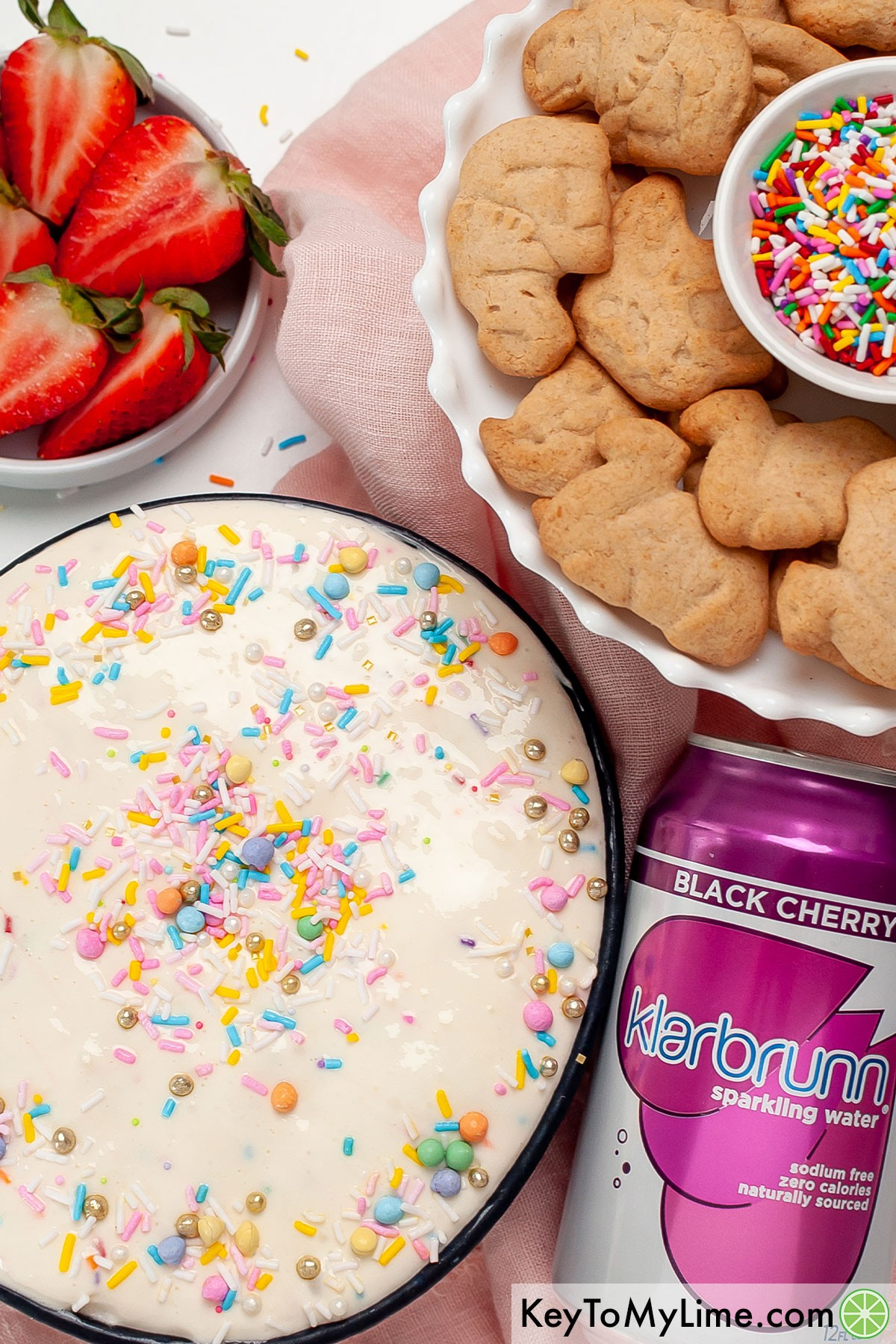 A bowl of funfetti dip next to a can of Klarbrunn sparkling water.