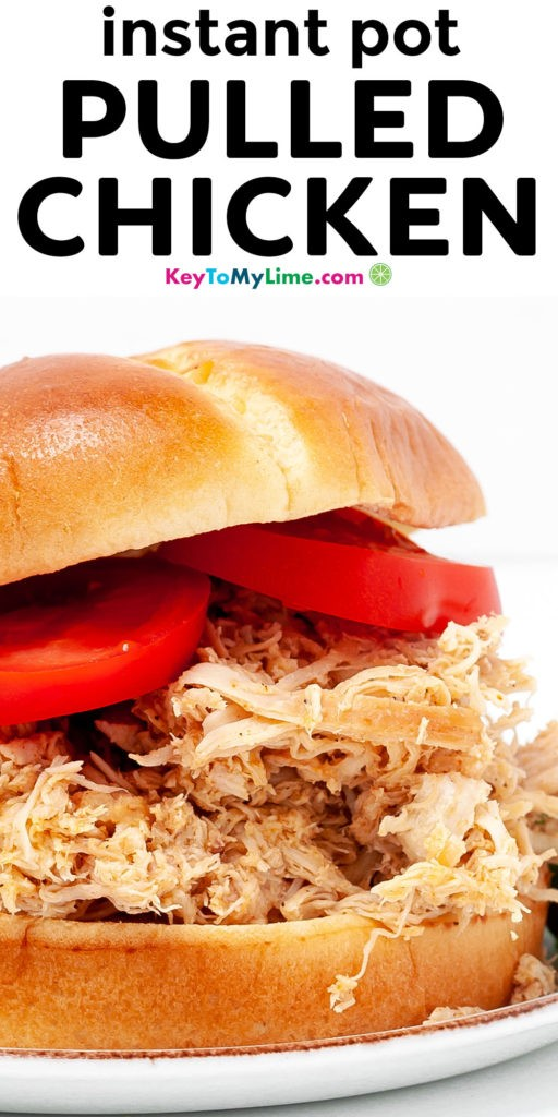 A Pinterest pin image with a close up picture of a pulled chicken sandwich and title text.