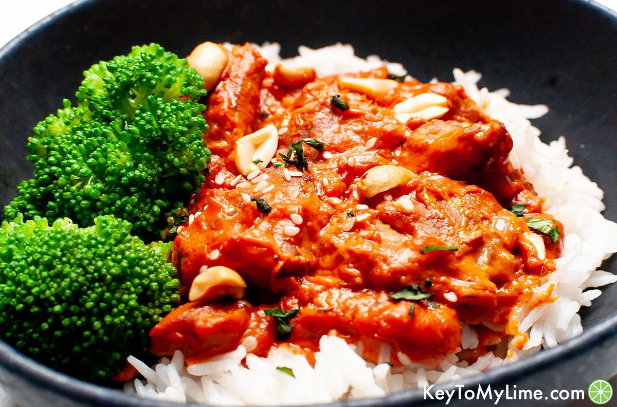 Peanut butter chicken served with rice and broccoli.