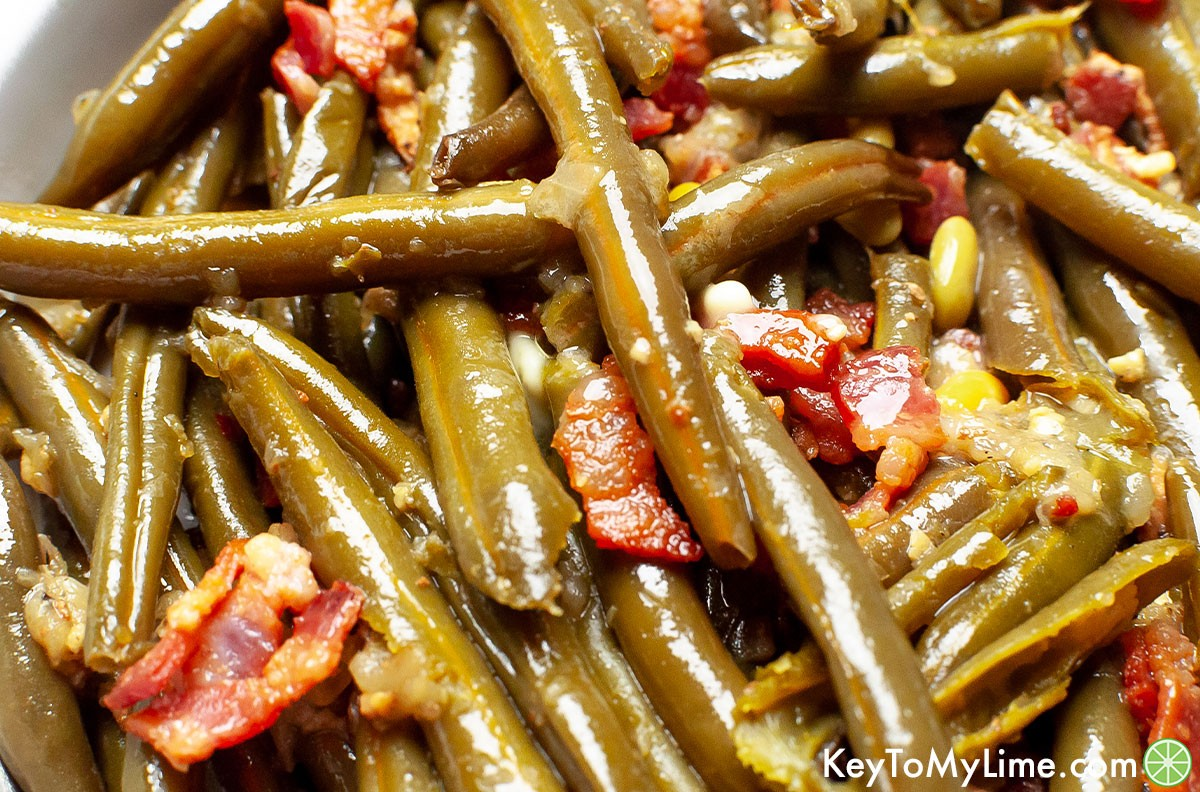 A close up image of Crockpot green beans with bacon.