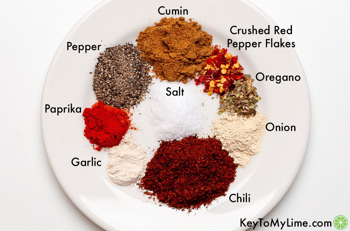 Homemade taco seasoning ingredients labeled on a white plate.