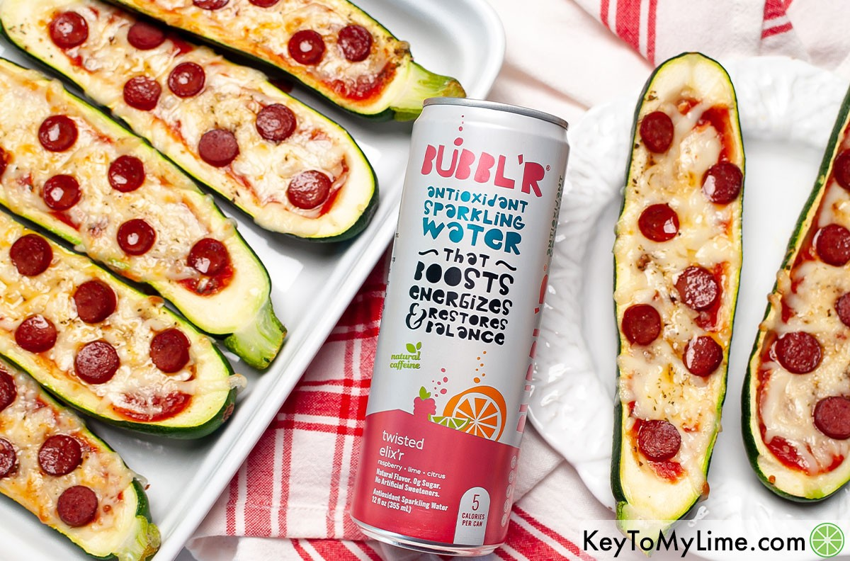 Zucchini pizza boats next to a can of BUBBL'R.