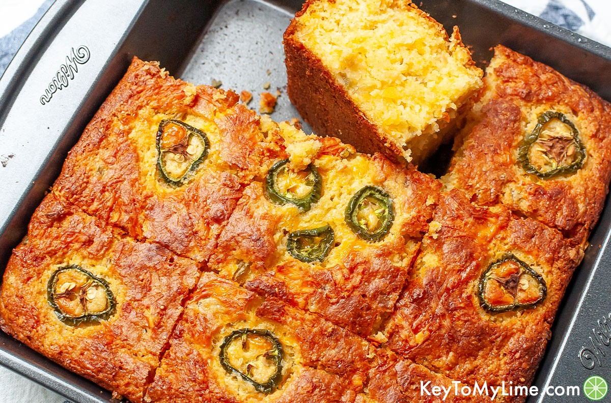 A baking dish filled with slices of Mexican cornbread.