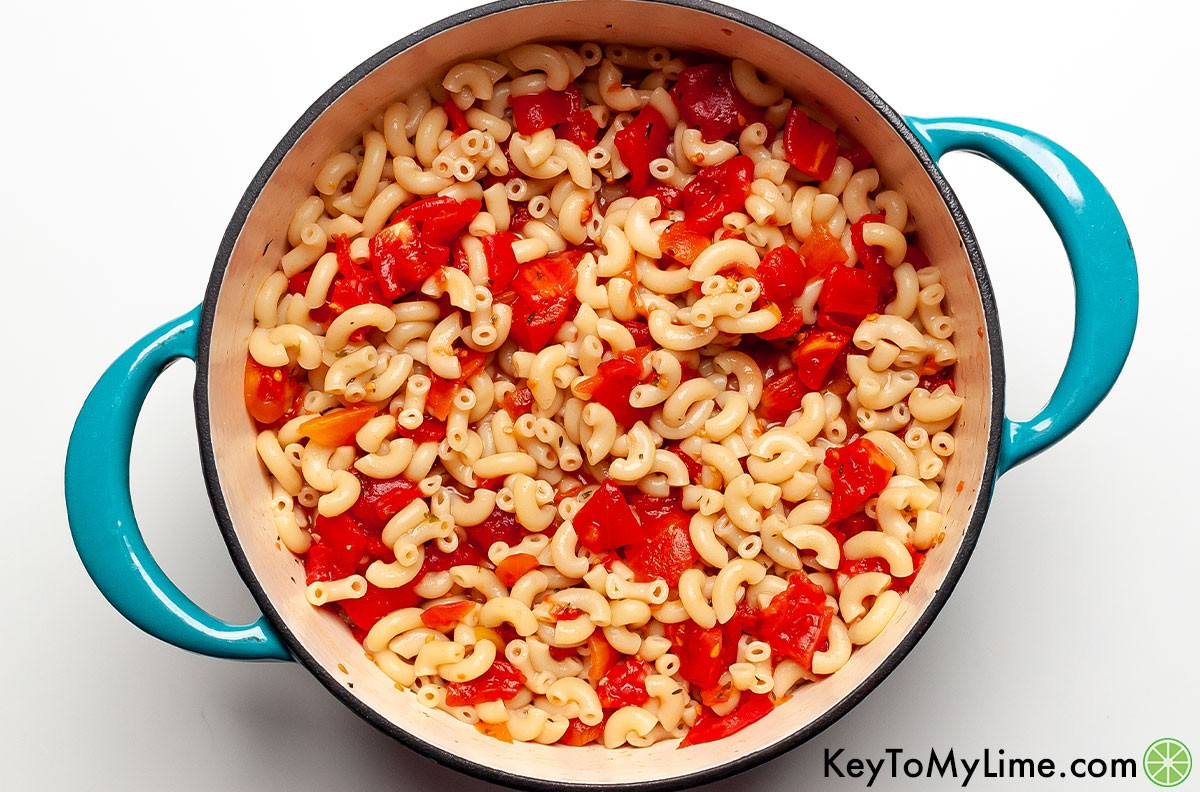 Overhead image of Macaroni and tomatoes in a Dutch oven.