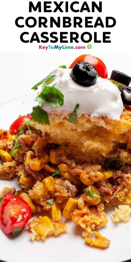 A Pinterest pin image of a serving of Mexican cornbread casserole with title text at the top.
