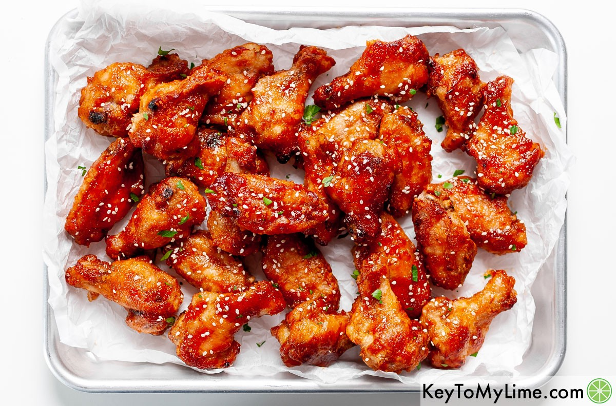A tray of sweet and sour chicken wings.