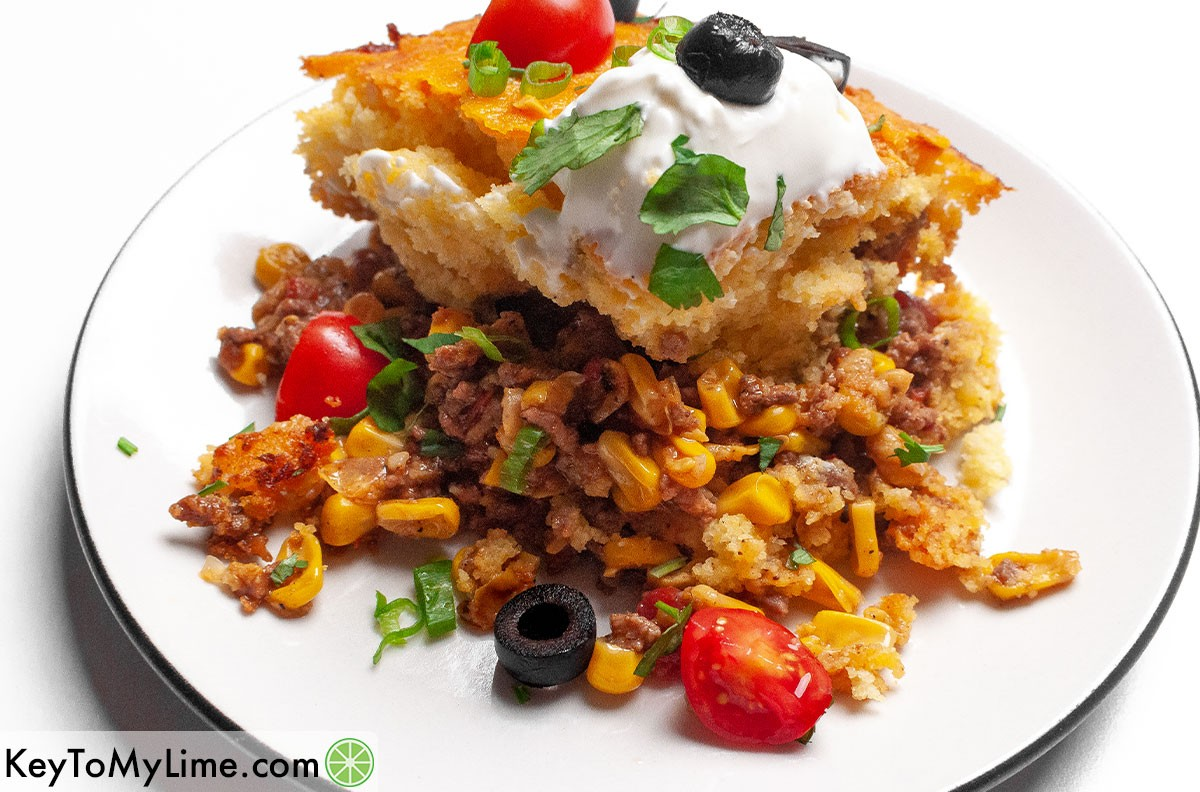 A serving of Jiffy Mexican cornbread casserole on a plate.