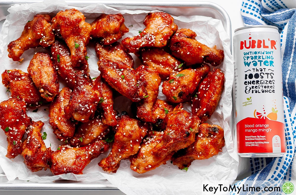 Sweet and sour chicken wings next to a can of BUBBL'R.