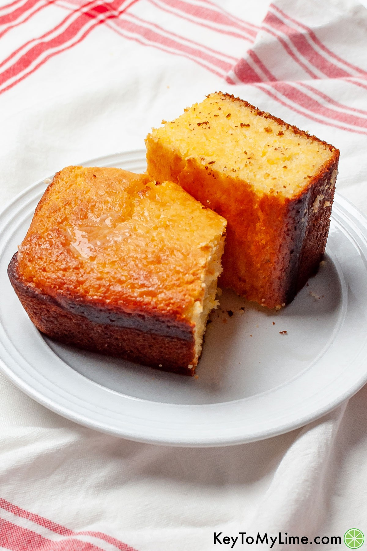 A white plate with two pieces of Jiffy cornbread.