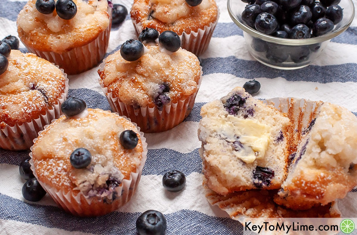 Easy blueberry muffins smeared with butter.