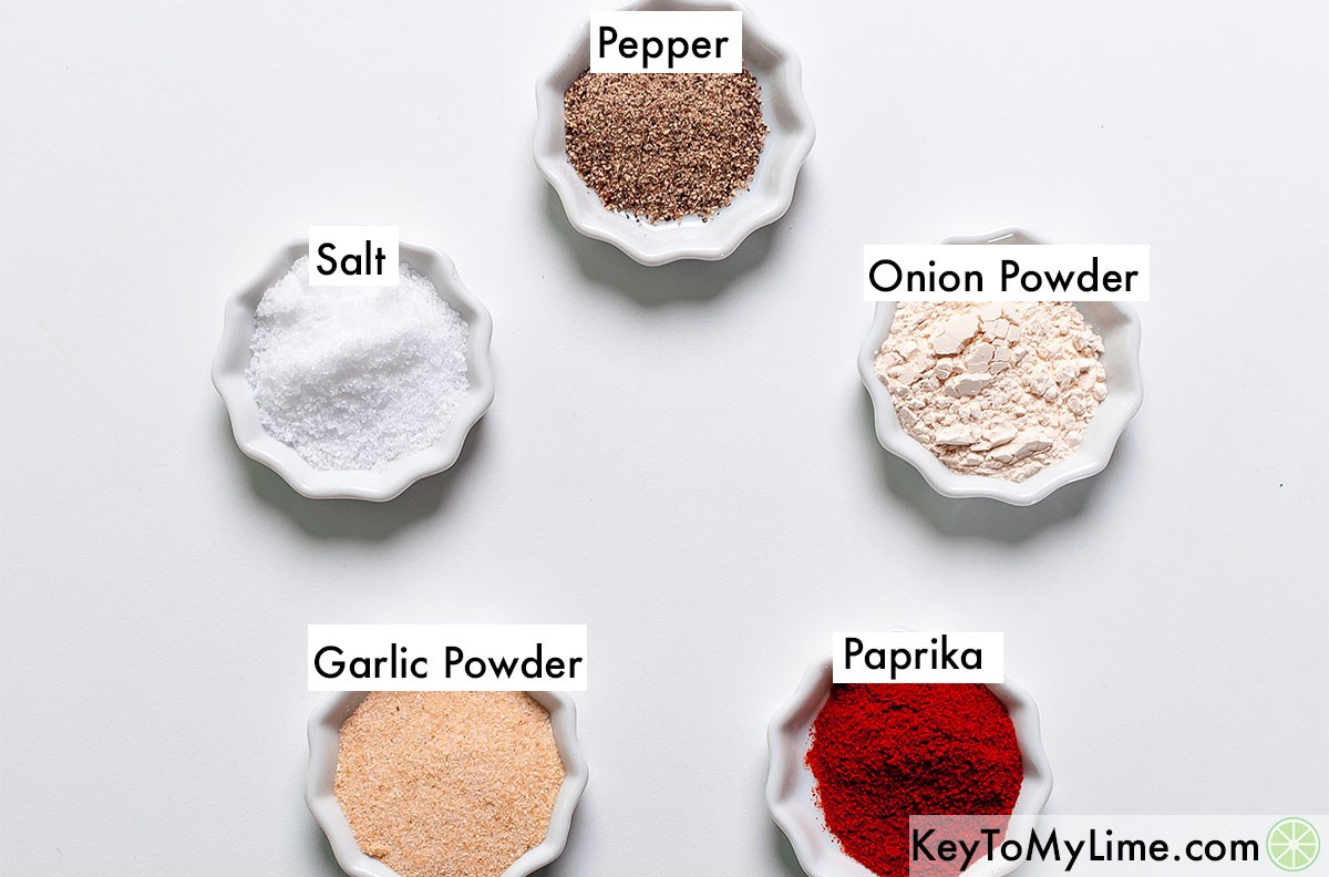 Salt, pepper, onion powder, garlic powder, and paprika containers labeled.