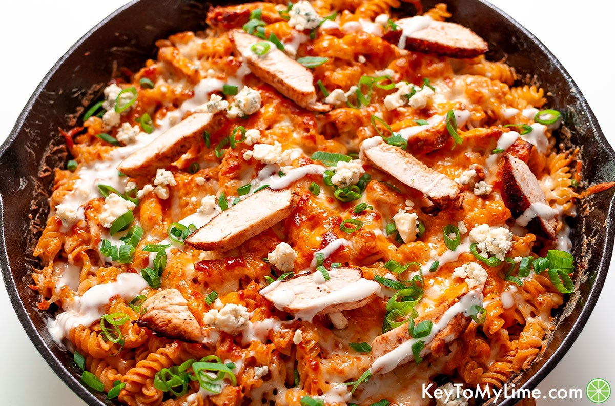 Buffalo chicken pasta with chicken strips on top.