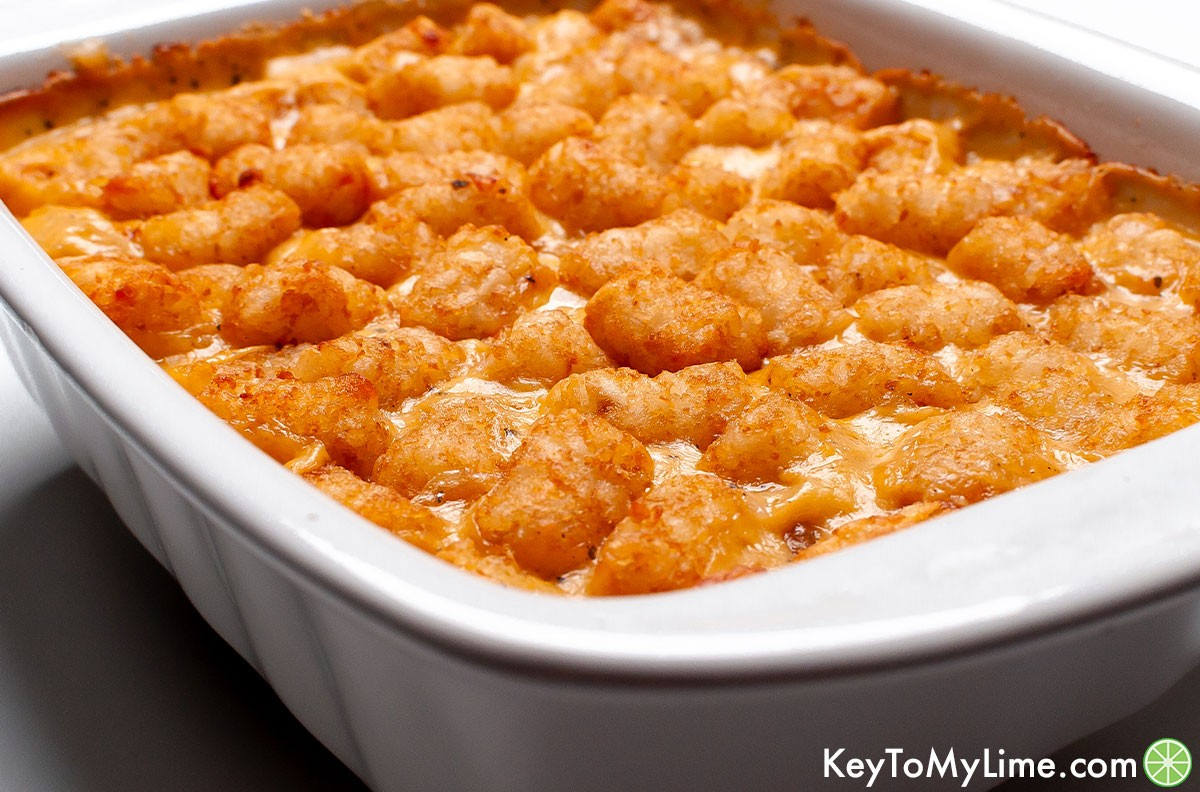 A side image of a cheesy chicken tater tot casserole.