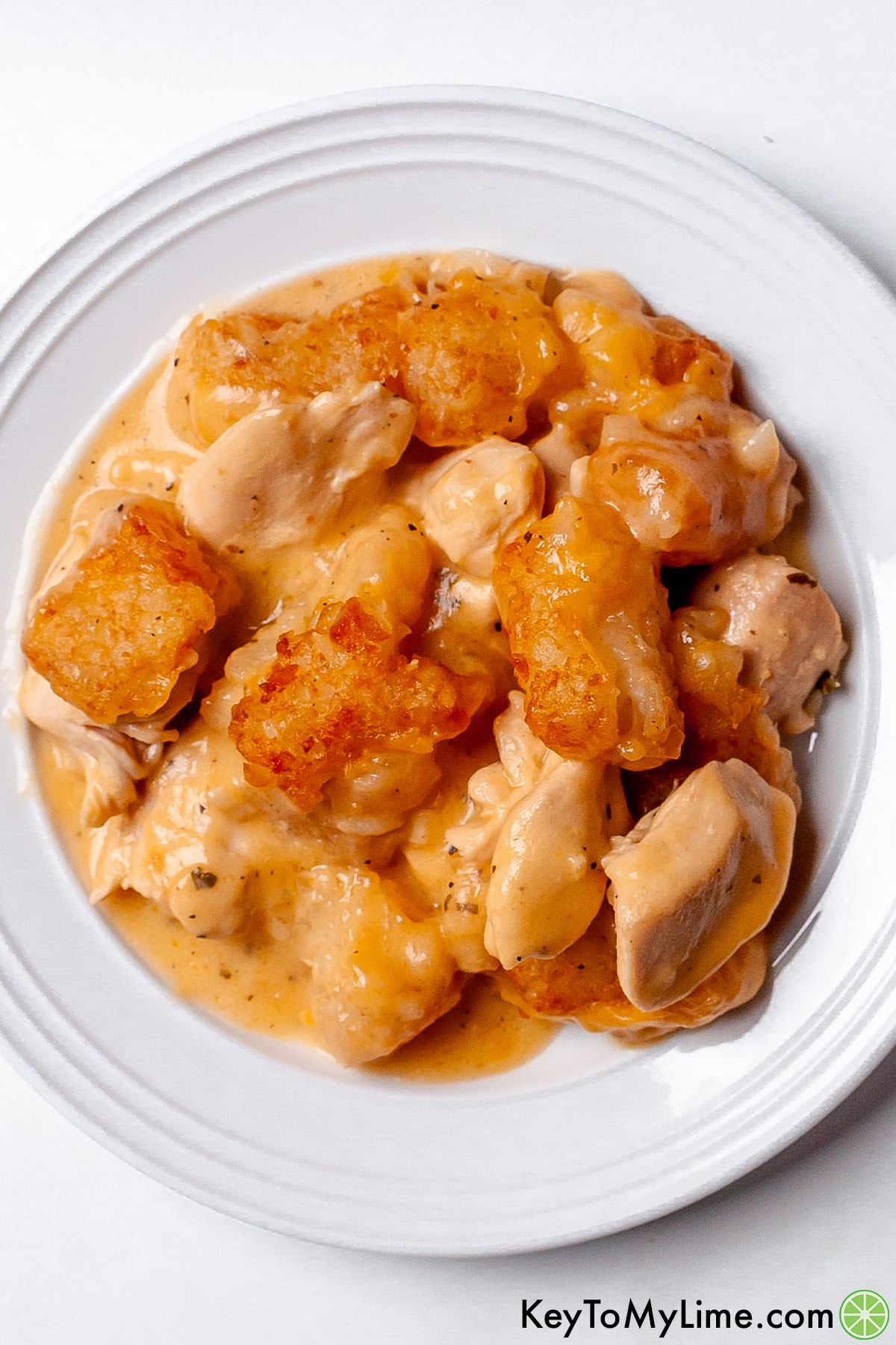 A serving of chicken tater tot casserole on a plate.