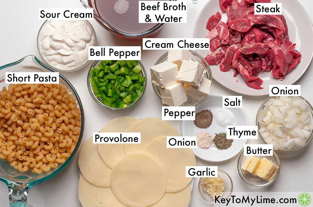 The labeled ingredients for Philly cheesesteak pasta.