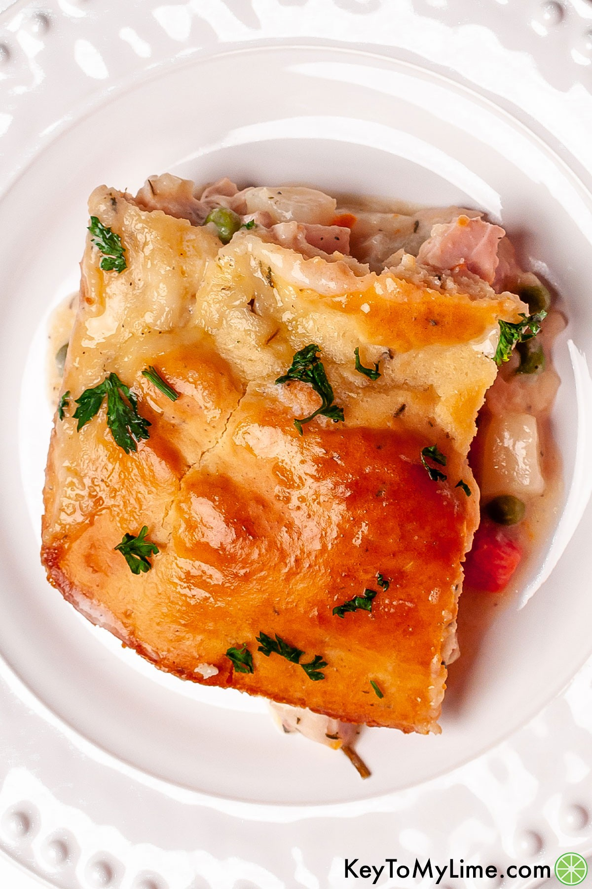 A piece of Bisquick chicken pot pie on a plate.