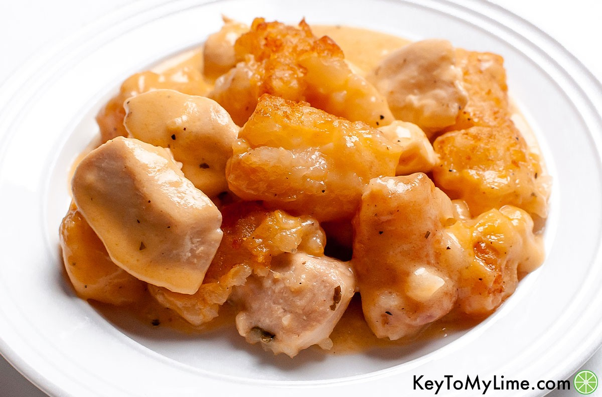 A serving of cheesy ranch tater tot casserole on a plate.