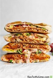 Four halves of two crunchwraps in a stack.